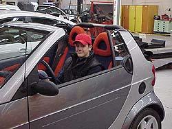 Julien Lee sitting in the SMART cabriolet