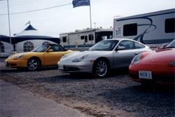 Two Porsche Boxster S's and a 911