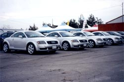 Four Audi TTs wait to be driven