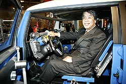 Ken Tomikawa, President Toyota Canada, with FTX Hybrid V8 pickup, Toronto Auto Show, February 2005