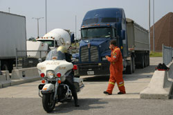 A truck comes in for inspection. The electronic inspection reports will be available to officers immediately on their in-car computers.