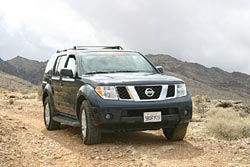 Several SUVs with various sizes and profiles of tires were used; here, a Nissan Pathfinder takes to the trail