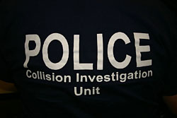 The officers often wear T-shirts for their field work, since they can spend a lot of time crawling through ditches and into vehicles to collect evidence