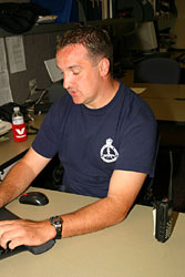 Detective Constable Dave Ashfield at his desk. The division uses sophisticated computer programs to reconstruct the collision