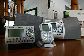 Portable XM Satellite Radio units,  one (right) placed into a home system.