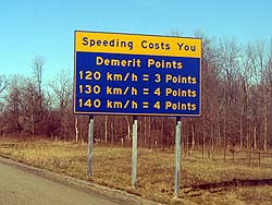 Signs along Ontario's Highway 401 serve as reminders of the possible cost of speeding