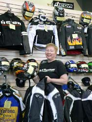 Jill Ruth displays a selection of motorcycle gear.
