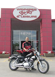 Gerald O'Neil of Winnipeg Sport and Leisure with Clark's new Virago