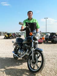 Tim Turner, Service Manager at Headingley Sport Shop, with a 1981 Yamaha 210.