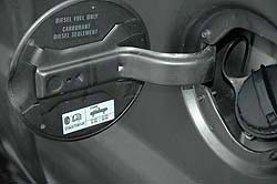 Sticker inside fuel filler door shows tire size and type