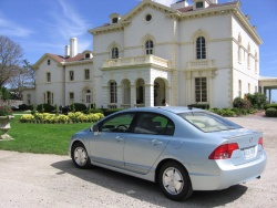 Our Civic parked in front of one of Newport's many mansions
