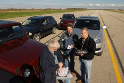 Journalists judging the SUV under $35,000 category at the AJAC Car of the Year TestFest commiserate