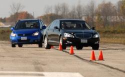 Journalists at TestFest track-test a Suzuki SX4 and a Mercedes-Benz S-Class