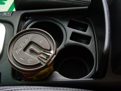 The console-mounted cupholder in the Nissan Altima can accommodate three different sizes of drink container