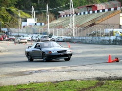 Author Obara pilots his Nissan Skyline through an autocross course