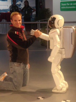 Honda's ASIMO robot at the Canadian Grand Prix with Honda F1 driver Rubens Barichello