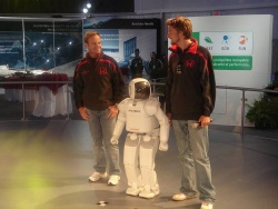 Honda's ASIMO robot at the Canadian Grand Prix with Honda F1 drivers Jensen Button and Rubens Barichello