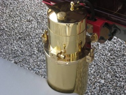 A generator combines calcium carbide and water to produce acetylene for the headlamps