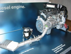 BMW 3.0-litre twin-turbo diesel engine; note urea injection system, just left of engine