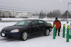 Fueling station attendant Ignacio Ison fills the Impala's tank