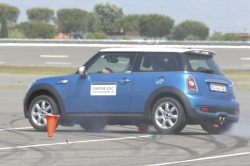 A driver demonstrates ESC in a Mini Cooper at a ChooseESC! event in Rome.