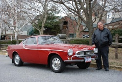 Irv Gordon stands beside his 2.6 million mile 1966 Volvo P1800