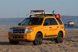 The Ford Motor Company has presented the Los Angeles County Lifeguards with the first ten of a fleet of 45 all-wheel drive Escape Hybrids, specially equipped for use on rescue patrol along 72 miles (115 km) of Southern California coastline.
