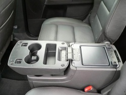 The rear console houses four cupholders - but you can only access two at a time