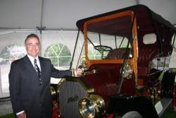 GM of Canada president Arturo Elias with a 1908 McLaughlin