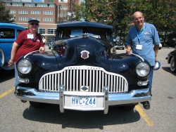 Wes and Lois Ebbs with their 1942 McLaughlin-Buick, called a blackout because the painted trim wouldn't reflect lights during a war air raid