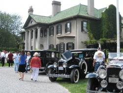 Cars on the front lawn outside the estate's front door