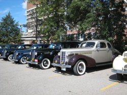 A row of McLaughlin-Buicks in Parkwood's rear lot