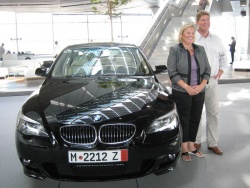 Steven and Karen Fenton pose for a BMW photographer, who presents them with a framed copy before they leave the building