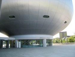 The entrance to the Museum is through the original bowl-shaped building