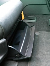 There's a glove box-like compartment under the front passenger seat