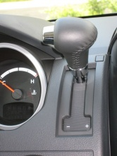 The shift lever moves to a new home on the dash