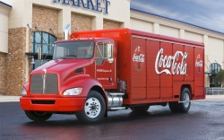 Kenworth has announced an order for 185 hybrid trucks from Coca-Cola, the truck manufacturer\'s largest-ever truck order.
