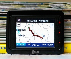 The pile of maps and guide books replaced by the LG portable navigation unit was taller than the unit itself