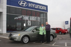 Ed Milburn of Clarington Hyundai (right) presenting the author's mother with the keys to her new Sonata.