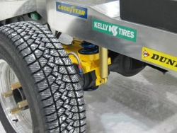 The traction truck uses electric motors to spin the rear wheels