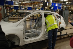 Ford associate demonstrates new electric power tool installing a side curtain airbag