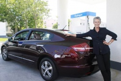 Jamie Lee Curtis, second customer of Honda's FCX Clarity hydrogen fuel cell-powered vehicle at a hydrogen filling station in West Los Angeles.