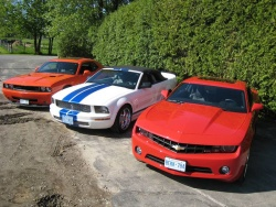 2010 Chevrolet Camaro RS V6 (right) with Shelby GT500 and Challenger