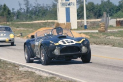 Carroll Shelby at wheel of new production Cobra, 1963