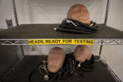 Dummy heads are used to test headliners