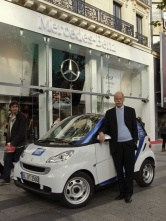 Dr. Dieter Zetsche, Chairman of the Board of Management of Daimler AG and Head of Mercedes-Benz Cars in front of the new Mercedes-Benz Gallery on the Champs Elysées with the Smart Car2Go edition, the world's first series-production car-sharing vehicle.