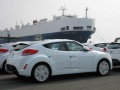 Hyundai Veloster and container ship at Ulsan factory, Ulsan, Korea