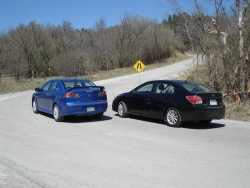 Subaru Impreza (right) and Mitsubishi Lancer SE AWC