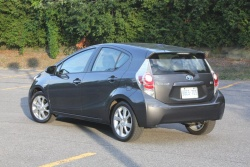 "2012 Toyota Prius /></a><br />2012 Toyota Prius C. Click image to enlarge</td> </tr> </table> <p>It&#8217;s also worth noting that, as is the case with most hybrids, the Prius C shines in city driving. that&#8217;s where I squeezed the best economy out of this car, whereas my observed average fuel consumption in highway driving was always close to 5.0 L/100 km. Hilly roads proved particularly taxing, forcing the little gas engine to go nearly flat-out to crest steeper hills and reach the easy ride back down.</p> <p>The point of all this is to say that while most hybrids are good at saving fuel by design, the biggest economic rewards will go to a careful driver who tailors his or her style to take advantage of the car&#8217;s capabilities. In the Prius&#8217; case, those include being able to run on electricity alone at low speeds and in light acceleration, and using the hybrid system&#8217;s regenerative braking capability by thinking ahead and slowing down more gradually than you might in a non-hybrid.</p> <p>It&#8217;s a driving style that&#8217;s lost on many drivers, partly due to impatience, but also because it&#8217;s not what most people consider fun. The thing is, most driving techniques that you might employ to maximize hybrid economy will work in any vehicle.</p> <p>Hybrid drive system aside, the Prius C certainly appealed to my small car sensibilities. It was a cinch to drive in city traffic, save for its wide turning circle, which I never got used to. Every time I pulled a u-turn or three-point turn in another vehicle, I or my wife would immediately comment ""that wouldn&#8217;t have worked in the Prius."" Even the relatively massive Infiniti JX crossover, which I drove near the end of the Prius C&#8217;s stay with us, could turn a tighter circle (relative to its size).</p> <div class='yarpp-related yarpp-related-none'> </div>                   </div>                     <div style="