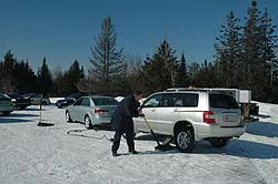 Ben Lalonde of Commercial Tire in Ottawa changes tires on the Toyota Highlander